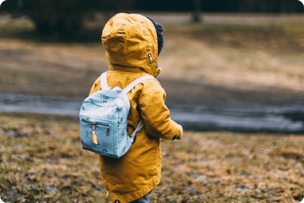 child in backpack